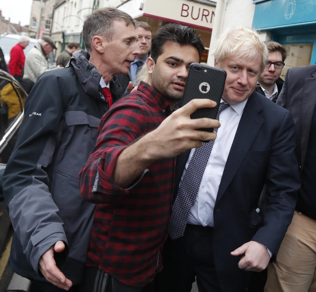 Britain's Prime Minister Boris Johnson has his picture taken during a General Election campaign stop in Wells, England, Thursday, Nov. 14, 2019. Britain goes to the polls on Dec. 12. (AP Photo/Frank Augstein, Pool)