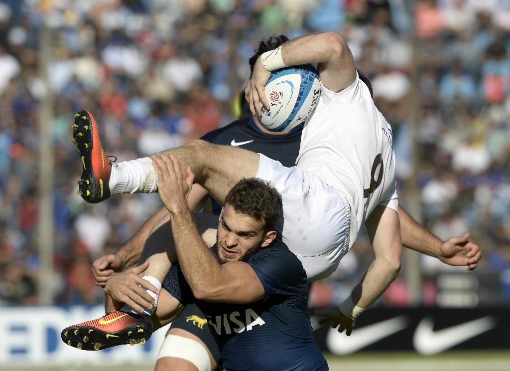 Georgia's scrum-half Vasil Lobzhanidze (R) is tackled by Argentina's Los Pumas wing Ramiro Moyano during their Rugby Union test match at 23 de Agosto stadium in San Salvador de Jujuy, Jujuy, Argentina on June 24, 2017 (AFP Photo/JUAN MABROMATA)