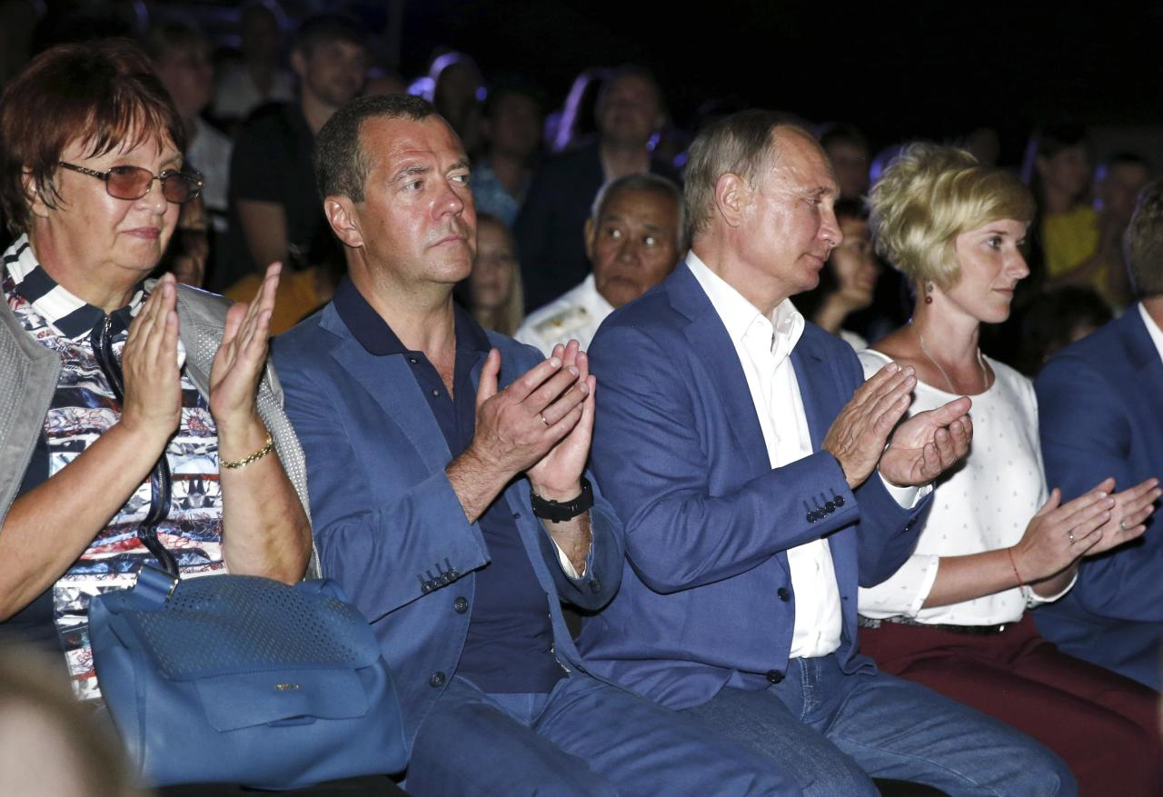 """Russia's President Vladimir Putin (2nd R) and Prime Minister Dmitry Medvedev (2nd L) attend the musical festival """"Opera in Chersonese"""" in the Black Sea port of Sevastopol, Crimea August 18, 2017. Sputnik/Dmitry Astakhov/Pool via REUTERS ATTENTION EDITORS - THIS IMAGE WAS PROVIDED BY A THIRD PARTY."""