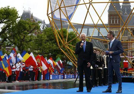 Svein Arne Hansen, President of the European Athletic Association, speaks next to TV host Jeroen Stomphorst during the official opening ceremony of the European Athletics Championships 2016. European championships - Amsterdam - 5/7/16  REUTERS/Michael Kooren