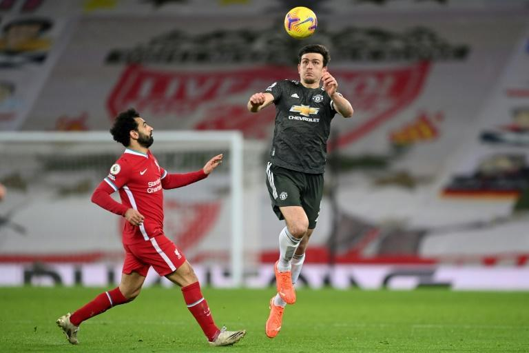 Manchester United captain Harry Maguire (right)expects his side to inflict more pain on Liverpool come Sunday
