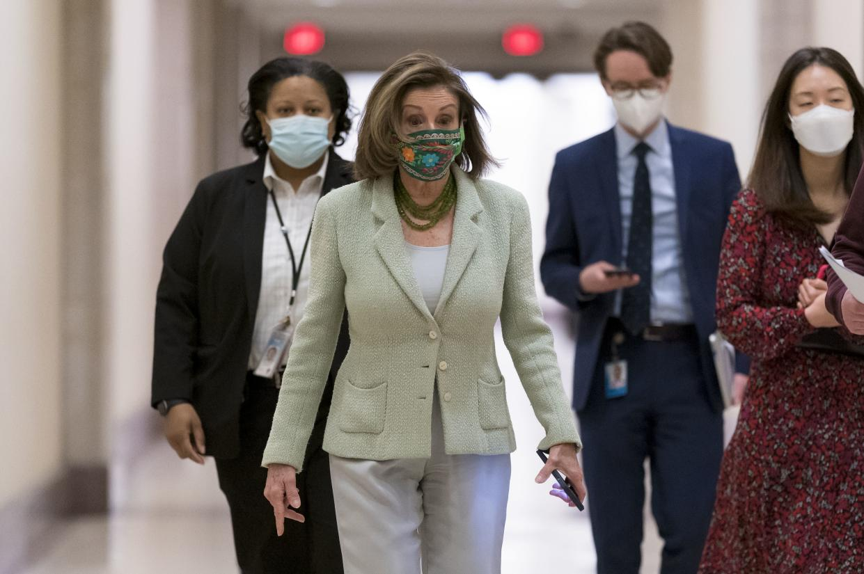 Speaker of the House Nancy Pelosi, D-Calif., leaves a news conference day after advancing sweeping voting and ethics legislation, and passing the George Floyd Justice in Policing Act, at the Capitol in Washington, Thursday, March 4.