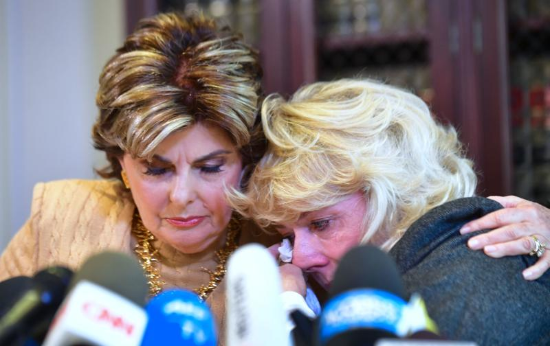 Heather Kerr, right, reacts after alleging in a news conference that she was sexually harassed by film producer Harvey Weinstein. Attorney Gloria Allred is at her side. (Frederic J. Brown/AFP/Getty Images)