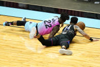 Miami Heat forward Jimmy Butler (22) and Philadelphia 76ers forward Danny Green (14) go for a loose ball during the second half of an NBA basketball game Thursday, May 13, 2021, in Miami. (AP Photo/Lynne Sladky)