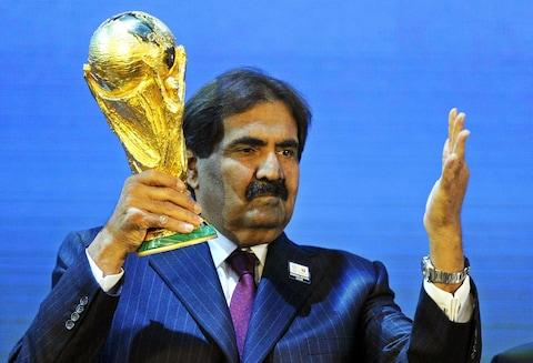 Sheikh Hamad bin Khalifa Al-Thani, Emir of Qatar, with the World Cup trophy after Qatar was announced to host the FIFA soccer World Cup 2022 during the FIFA 2018 and 2022 World Cup Bid Announcement in Zurich - Credit: Walter Bieri/FIFA