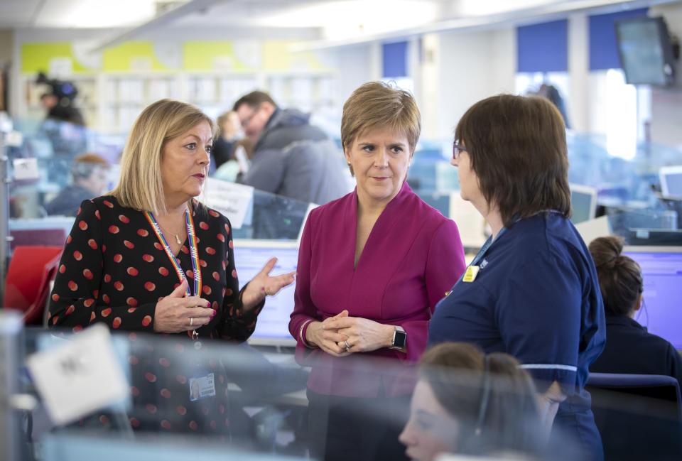 GLASGOW, SCOTLAND - MARCH 4: Scotland's First Minister Nicola Sturgeon, with Associate Director of Nursing and Operations, Janice Houston (left), meets staff supporting Scotland's public information response to coronavirus (COVID-19) during a visit to the NHS 24 contact centre at the Golden Jubilee National Hospital on March 4, 2020 in Glasgow, Scotland.  (Photo by Jane Barlow-Pool/Getty Images)