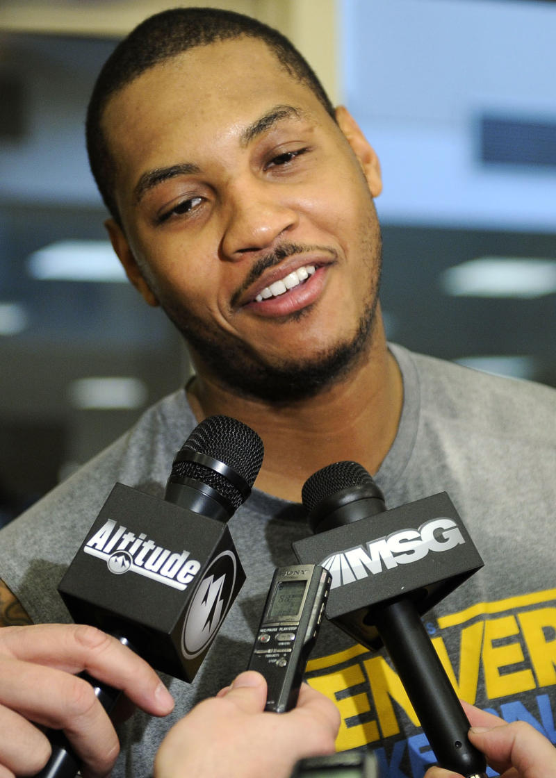 Denver Nuggets forward Carmelo Anthony speaks with the media after a NBA basketball practice Saturday, Dec. 11 , 2010 in New York. (AP Photo/Stephen Chernin)