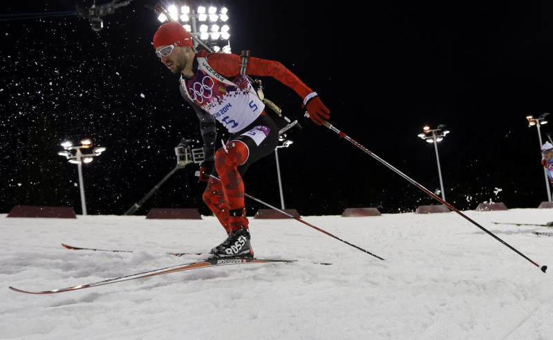 Canada's Jean-Philippe le Guellec competes during the men's biathlon 12.5k pursuit, at the 2014 Winter Olympics, Monday, Feb. 10, 2014, in Krasnaya Polyana, Russia. (AP Photo/Kirsty Wigglesworth)