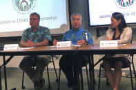 In this Feb. 14, 2020, file photo Hawaii Gov. David Ige, center, state Health Director Bruce Anderson, left, and state Epidemiologist Sarah Park, right, in Honolulu discuss a tourist who was confirmed with the coronavirus after returning home to Japan. A review of Ige's emails shows the state epidemiologist spent key weeks in the early days of the coronavirus pandemic resisting suggestions and requests from both inside and outside the administration that she boost contract tracing to control the spread of COVID-19. (AP Photo/Jennifer Sinco Kelleher, File)