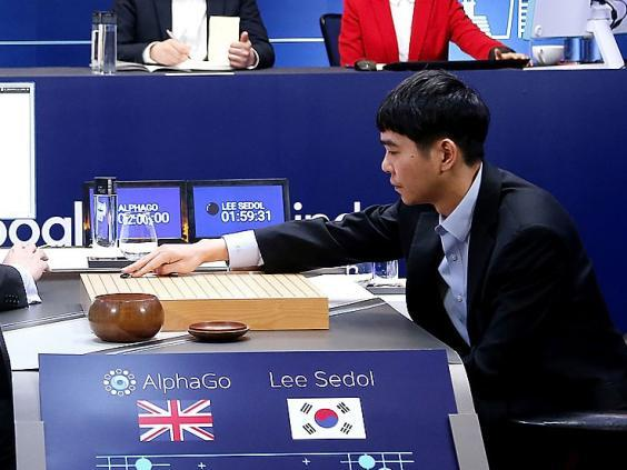 Lee Sedol plays his first move against AlphaGo (Google via Getty Images)