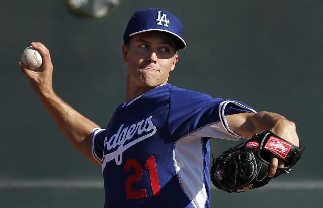 FILE - In this Monday, Feb. 10, 2014 file photo, Los Angeles Dodgers pitcher Zack Greinke throws during spring training baseball practice in Glendale, Ariz. Greinke and the Los Angeles Dodgers have knocked Rodriguez and the New York Yankees off baseball's payroll perch. The Dodgers as of Tuesday, March 25, 2014 had a projected payroll of $235 million, according to study of all major league contracts by The Associated Press. (AP Photo/Paul Sancya, File)