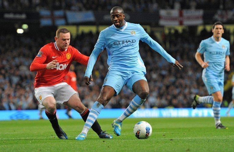 Manchester City's Ivorian midfielder Yaya Toure shields the ball from Manchester United's Wayne Rooney during a Premier League match in Manchester, north-west England, on April 30, 2012. Ivory Coast is in a strong position to capture the CAF Footballer of the Year award on Thursday, with two of its stars, Toure and Didier Drogba, Drogba, nominated against an up-and-coming midfielder from Cameroon