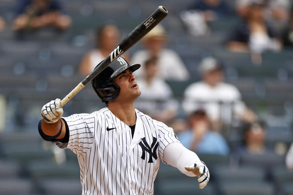 New York Yankees' Mike Ford watches his solo home run during the fifth inning of a baseball game against the Chicago White Sox on Saturday, May 22, 2021, in New York. (AP Photo/Adam Hunger)