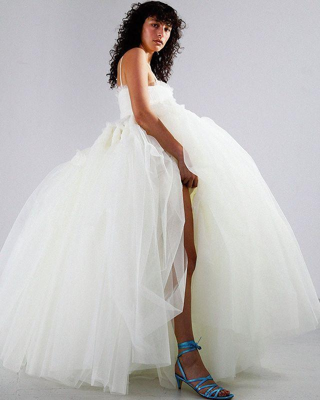 """<p><a class=""""link rapid-noclick-resp"""" href=""""https://mollygoddard.com/collections/bridal-made-to-order"""" rel=""""nofollow noopener"""" target=""""_blank"""" data-ylk=""""slk:SHOP MOLLY GODDARD BRIDAL"""">SHOP MOLLY GODDARD BRIDAL</a></p><p>One of London Fashion Week's best-loved designers, Molly Goddard is known for her trademark tulle frocks and fun take on ladylike dressing. Last year, Goddard launched her first line of wedding dresses with which she aimed to """"celebrate the joy in fashion"""", <a href=""""https://www.harpersbazaar.com/uk/bazaar-brides/a34698650/molly-goddard-bridal/"""" rel=""""nofollow noopener"""" target=""""_blank"""" data-ylk=""""slk:she told us"""" class=""""link rapid-noclick-resp"""">she told us</a>. You'll find enormous frothy dresses as well as more toned-down styles, but each dress is certainly something unique and a move away from tradition.</p><p><a href=""""https://www.instagram.com/p/CHsJEh2j7tD/?utm_source=ig_embed&utm_campaign=loading"""" rel=""""nofollow noopener"""" target=""""_blank"""" data-ylk=""""slk:See the original post on Instagram"""" class=""""link rapid-noclick-resp"""">See the original post on Instagram</a></p>"""