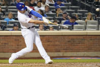 New York Mets pinch-hitter Brandon Drury hits a solo home run during the seventh inning of the team's baseball game against the Atlanta Braves, Wednesday, July 28, 2021, in New York. (AP Photo/Mary Altaffer)