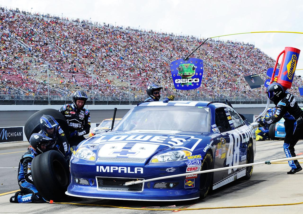 BROOKLYN, MI - JUNE 17:  Jimmie Johnson, driver of the #48 Lowe's Chevrolet, pits during the NASCAR Sprint Cup Series Quicken Loans 400 at Michigan International Speedway on June 17, 2012 in Brooklyn, Michigan.  (Photo by John Harrelson/Getty Images for NASCAR)