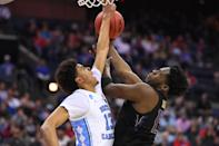 <p>Noah Dickerson #15 of Washington Huskies tries to shoot over Cameron Johnson #13 of the North Carolina Tar Heels in the second round of the 2019 NCAA Men's Basketball Tournament held at Nationwide Arena on March 24, 2019 in Columbus, Ohio. (Photo by Jamie Schwaberow/NCAA Photos via Getty Images) </p>