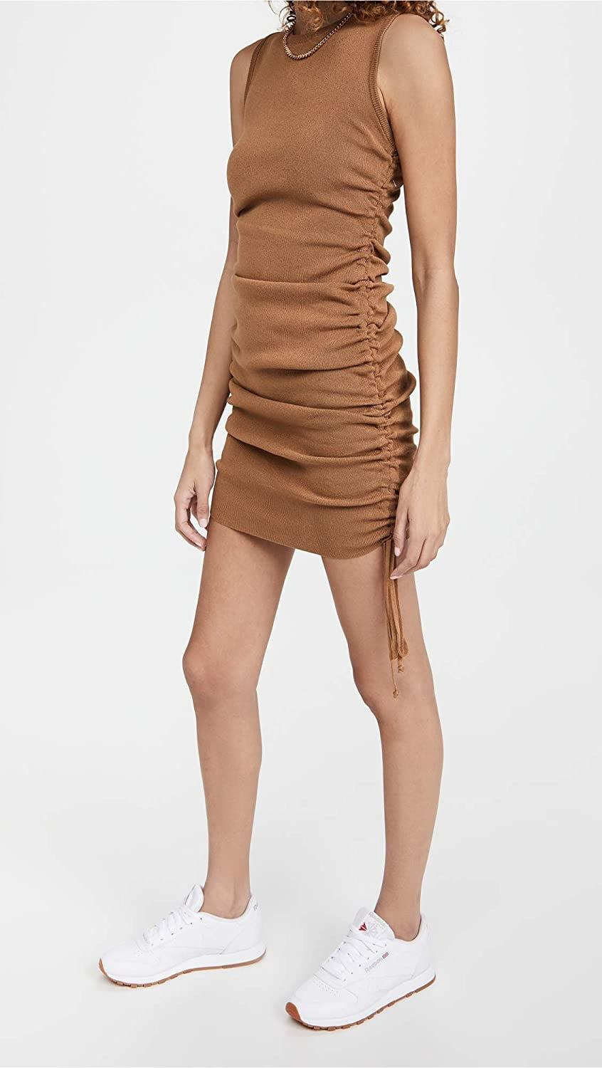 <p>This <span>Lioness Military Minds Minidress</span> ($79) is sexy and modern, plus there it has tons of styling possibilities. Keds sneakers? Yes. Kitten heels? Also yes.</p>
