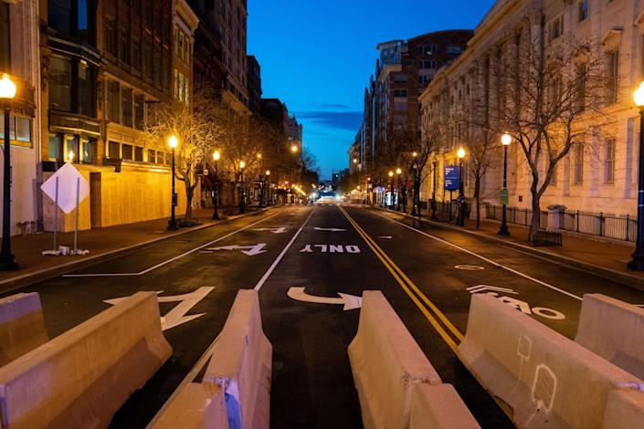 Barricades are placed on a street in downtown Washington DC.
