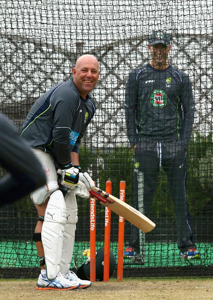 BRIGHTON, ENGLAND - JULY 25:  Darren Lehmann, coach of Australia, bats in the nets as Michael Clarke of Australia looks on during an Australian Training Session at The County Ground on July 25, 2013 in Brighton, England.  (Photo by Ryan Pierse/Getty Images)