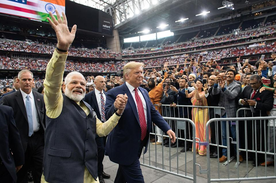 "Trump and Modi attend ""Howdy, Modi!"" at NRG Stadium in Houston on Sept. 22, 2019. Tens of thousands of Indian-Americans converged for an unusual joint rally, a symbol of the bond between the two leaders.<span class=""copyright"">Saul Loeb—AFP/Getty Images</span>"
