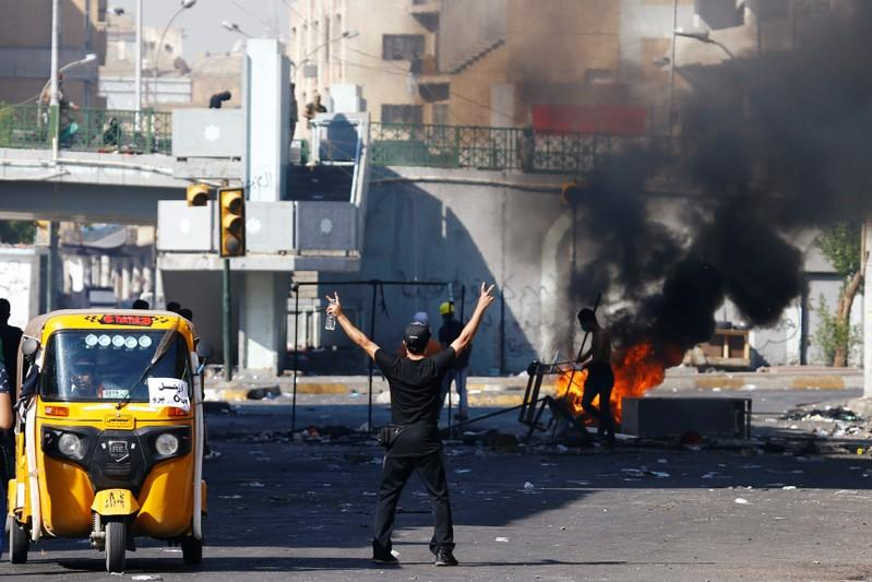Demonstrator gestures during the ongoing anti-government protests in Baghdad