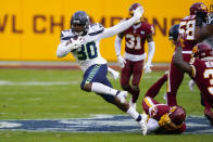 Seattle Seahawks running back Carlos Hyde (30) breaks away from Washington Football Team cornerback Ronald Darby (23) to begin his 50-yard touchdown run during the second half of an NFL football game, Sunday, Dec. 20, 2020, in Landover, Md. (AP Photo/Susan Walsh)