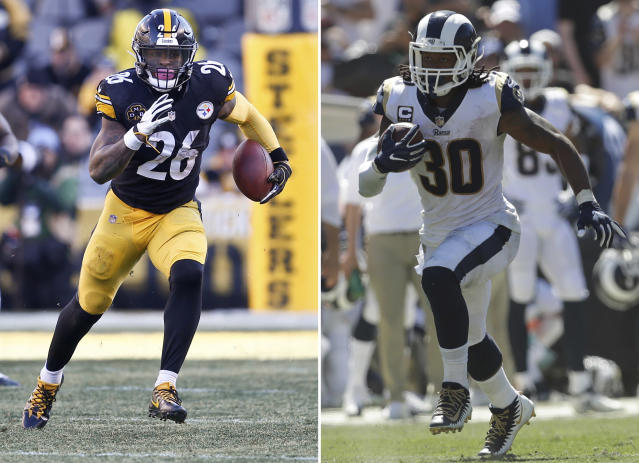 FILE - At left, in a Jan. 14, 2018, file photo, Pittsburgh Steelers running back Le'Veon Bell (26) plays in an NFL football game against the Jacksonville Jaguars, in Pittsburgh. At right, in a Sept. 16, 2018, file photo, Los Angeles Rams running back Todd Gurley runs against the Arizona Cardinals during the first half of an NFL football game, in Los Angeles. Todd Gurley of the Los Angeles Rams is the best running back in the league, as ranked by a panel of Associated Press NFL writers. Le'Veon Bell, though he has yet to sign his contract with the Pittsburgh Steelers this season, comes in second. (AP Photo/File)