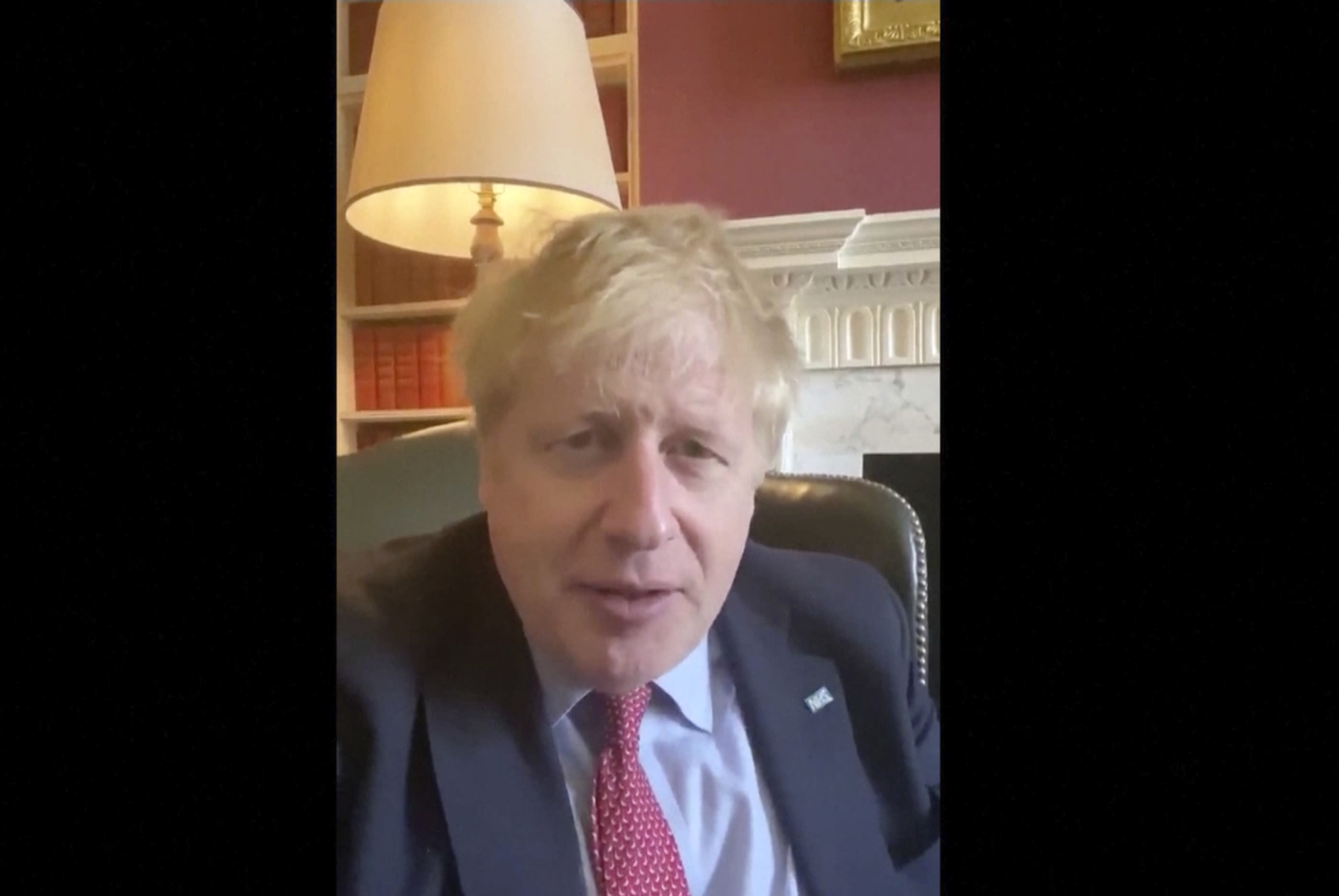 In this image taken from video of the TWITTER/@BorisJohnson, Britain's Prime Minister Boris Johnson announces he has tested positive for the new coronavirus, Friday March 27, 2020. Johnson's office said he was tested after showing mild symptoms and was now self-isolating, but would continue to lead the country's response to COVID-19. (TWITTER/@BorisJohnson via AP)