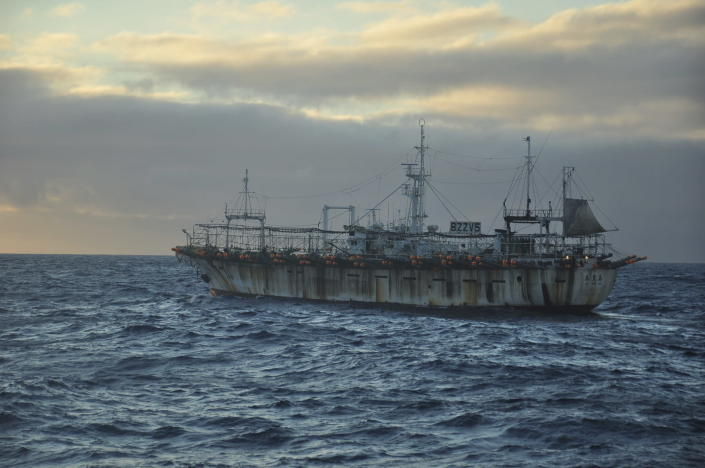 The Chinese-flagged Zhong Yuan Yu 16 sails at dusk on the high seas near the Galapagos Islands on July 18, 2021. In the summer of 2020, hundreds of Chinese vessels were discovered fishing for squid near the long-isolated Galapagos Islands, a UNESCO world heritage site that inspired 19th-century naturalist Charles Darwin and is home to some of the world's most endangered marine species, from giant tortoises to hammerhead sharks. (AP Photo/Joshua Goodman)