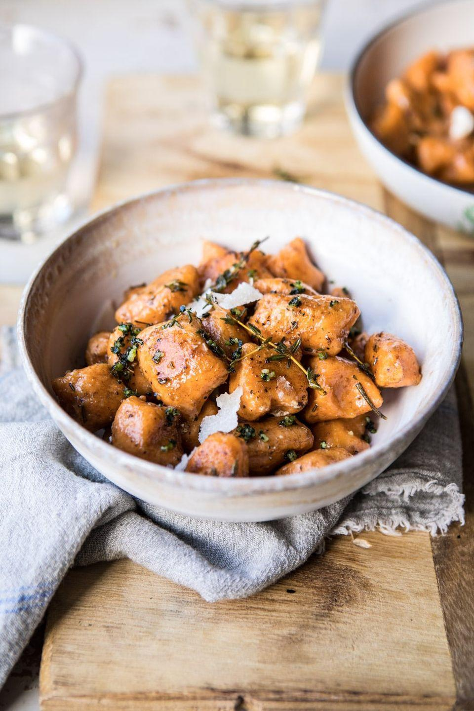 """<p>This four-ingredient recipe will become your favorite fall pasta dish.</p><p><strong>Get the recipe at <a href=""""https://www.halfbakedharvest.com/sweet-potato-gnocchi-with-herbed-white-wine-pan-sauce/"""" rel=""""nofollow noopener"""" target=""""_blank"""" data-ylk=""""slk:Half Baked Harvest"""" class=""""link rapid-noclick-resp"""">Half Baked Harvest</a>.</strong></p>"""