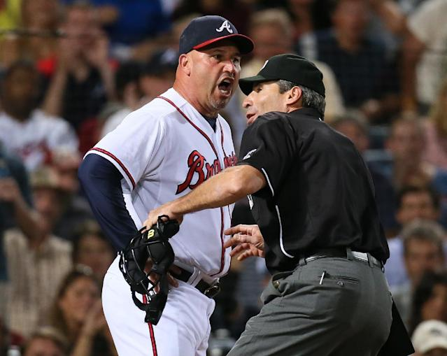 Atlanta manager Fredi Gonzalez gets ejected from a baseball game in Atlanta, Monday, Sept. 23, 2013 by home plate umpire Angel Hernandez in the seventh inning arguing a call that Paul Janish was hit by a pitch against Milwaukee. (AP Photo/Atlanta Journal-Constitution, Curtis Compton)