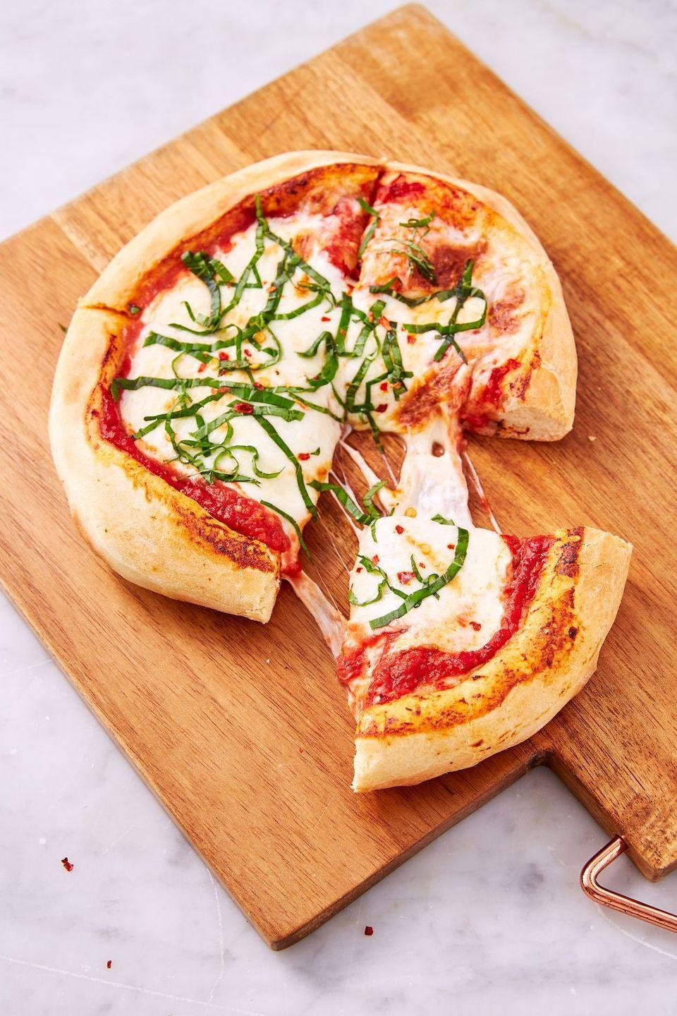 """<p>Making great <a href=""""https://www.delish.com/uk/cooking/recipes/a30686833/homemade-pizza-recipe/"""" rel=""""nofollow noopener"""" target=""""_blank"""" data-ylk=""""slk:homemade pizza"""" class=""""link rapid-noclick-resp"""">homemade pizza</a> can be hard, or so we thought. Turns out, we just hadn't tried making it in an air fryer yet! This super simple recipe yields some of the best pizza to ever come out of our kitchen. The air fryer excels in cooking crust—ours was airy in the centre and crunchy on the outside, just like in a true pizza oven! </p><p>Get the <a href=""""https://www.delish.com/uk/cooking/recipes/a34665610/air-fryer-pizza-recipe/"""" rel=""""nofollow noopener"""" target=""""_blank"""" data-ylk=""""slk:Air Fryer Pizza"""" class=""""link rapid-noclick-resp"""">Air Fryer Pizza</a> recipe.</p>"""