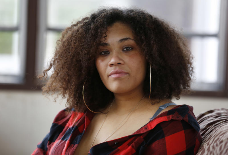 Arminta Jeffryes poses for a picture in her home in Newark, N.J., Thursday, June 22, 2017. Jeffryes was arrested while protesting police brutality. Then the police department played an unusual role in her court case. A New York Police Department lawyer stepped in to prosecute the jaywalking charge against her, in a low-level court that usually has no prosecutors at all. Jeffryes' lawyer says the police attorney wouldn't agree to a dismissal unless Jeffryes said her arrest was legitimate, which she contests. (AP Photo/Seth Wenig)