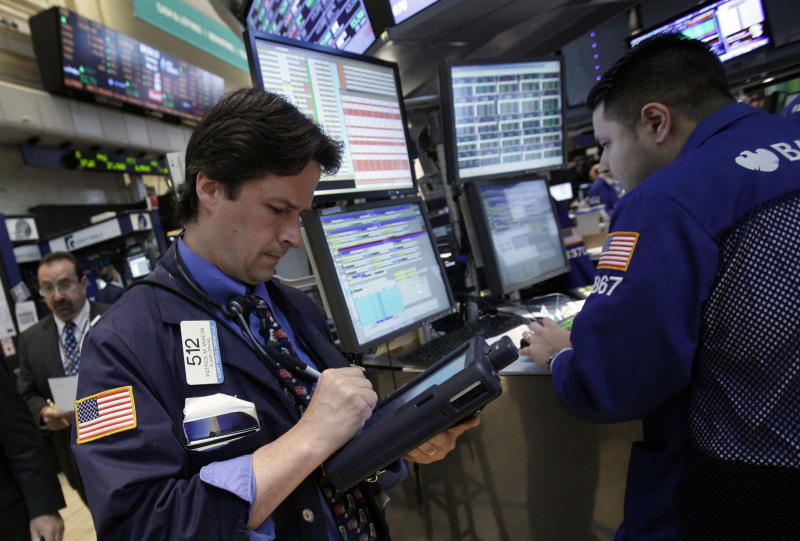 In a May 29, 2012 photo trader Patrick McKeon, left, works on the floor of the New York Stock Exchange.   Futures augured a lower opening on Wall Street Monday June 18, 2012 with Dow Jones industrial futures   and S&P 500 futuresboth down 0.4 percent  (AP Photo/Richard Drew)