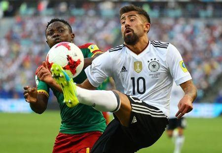 Cameroon's Collins Fai in action with Germany's Kerem Demirbay.    REUTERS/Kai Pfaffenbach
