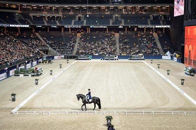 Equestrian - Sweden International Horse Show - FEI Grand Prix Freestyle to Music event - Friends Arena, Stockholm, Sweden - December 3, 2017 - Therese Nilshagen of Sweden rides her horse Dante Weltino OLD. TT News Agency/Jessica Gow via REUTERS ATTENTION EDITORS - THIS IMAGE WAS PROVIDED BY A THIRD PARTY. SWEDEN OUT. NO COMMERCIAL OR EDITORIAL SALES IN SWEDEN