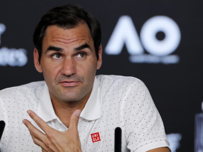 Switzerland's Roger Federer answers questions during a press conference ahead of the Australian Open tennis championship in Melbourne, Australia, Saturday, Jan. 18, 2020. (AP Photo/Andy Wong)