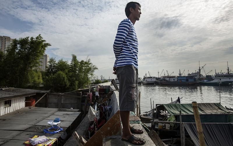Jakarta is one of the fastest-sinking cities in the world under the weight of out-of-control development and rising sea levels caused by global warming - Credit: Getty