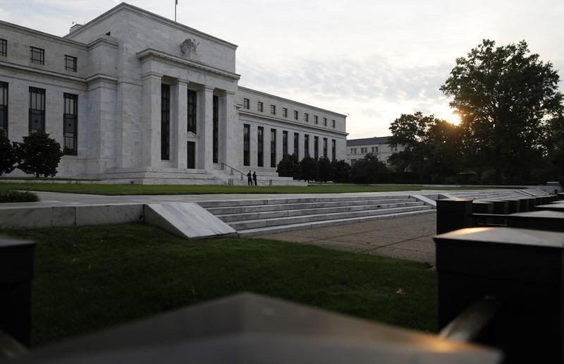 Sun rises to the east of the U.S. Federal Reserve building in Washington