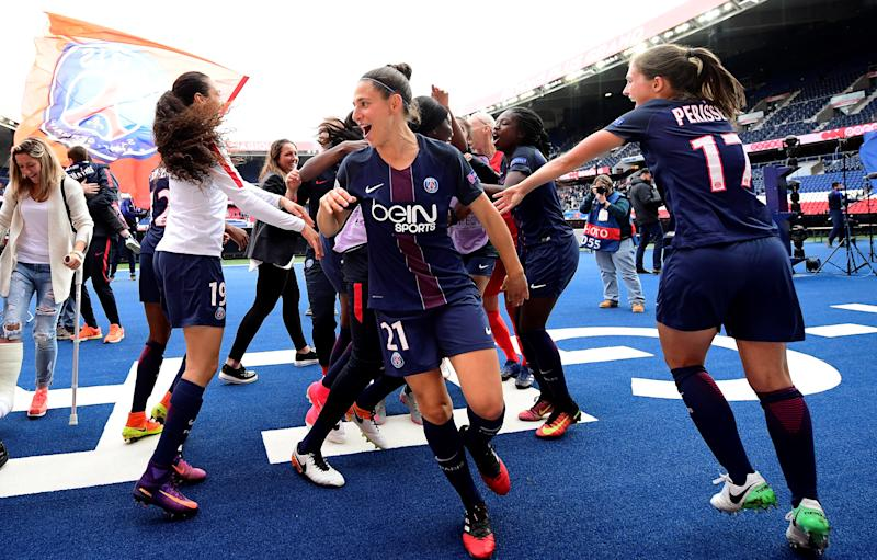 (from L) Paris Saint-Germain's German midfeilder Fatmire Alushi, Paris Saint-Germain's Spain midfielder Veronica Boquette and Paris Saint-Germain's French defender Eve Parisset celebrate their victory at the end of the UEFA Women's Champions League semi-f