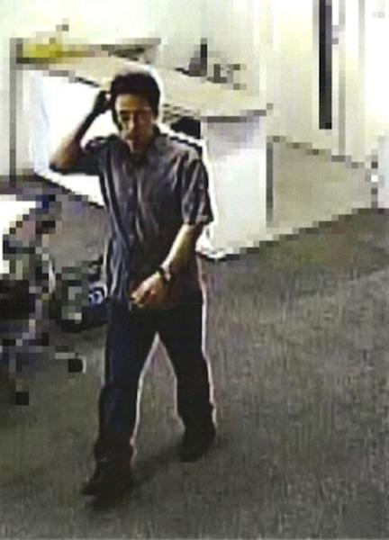 In this image taken from a June 4, 2012 security camera video and released by Tokyo Metropolitan Police Department Thursday, June 7, 2012, Katsuya Takahashi, the last remaining fugitive of the Aum Shinrikyo cult wanted as murder suspects in the 1995 sarin nerve gas attack on Tokyo subways, visits his office in Kawasaki, west of Tokyo. Thousands of police were mobilized Friday, June 8, to hunt for Takahashi suspected in the deadly nerve gas attack, which killed 13 people and injured more than 6,000. (AP Photo/Kyodo News) JAPAN OUT, MANDATORY CREDIT, NO LICENSING IN CHINA, HONG KONG, JAPAN, SOUTH KOREA AND FRANCE