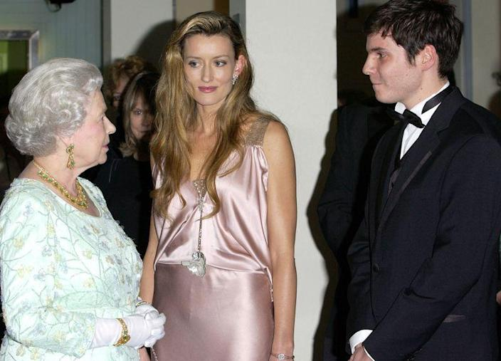 <p>While attending the premiere of <em>The Truman Show, </em>actress Natascha McElhone chatted with Queen Elizabeth while wearing a slinky, pink silk dress. Does it kind of remind you of a nightgown? No? Okay, that's fine. </p>