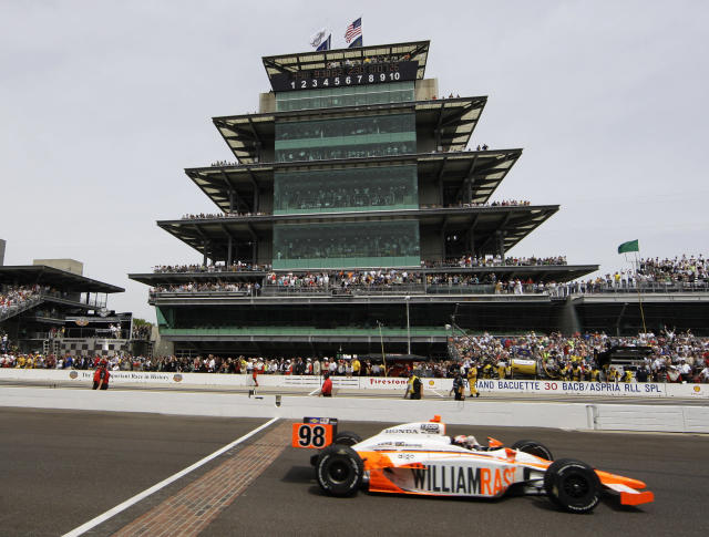 FILE - In this May 29, 2011, file photo, IndyCar driver Dan Wheldon, of England, crosses the finish line to win the Indianapolis 500 auto race at the Indianapolis Motor Speedway in Indianapolis. The Associated Press has updated its survey of living Indianapolis 500 winners and their pick as the greatest race in the long history of the event. There are six races that received multiple votes, topped by Al Unser Jr.s victory over Scott Goodyear in 1992 the closest Indy 500 in history. The others are Emerson Fittipaldi's win in 1989; Sam Hornish Junior's win in 2006; the 1982 battle between Rick Mears and Gordon Johncock; the 2011 race won by the late Wheldon; and the 2014 thriller won by Ryan Hunter-Reay.(AP Photo/Darron Cummings, File)