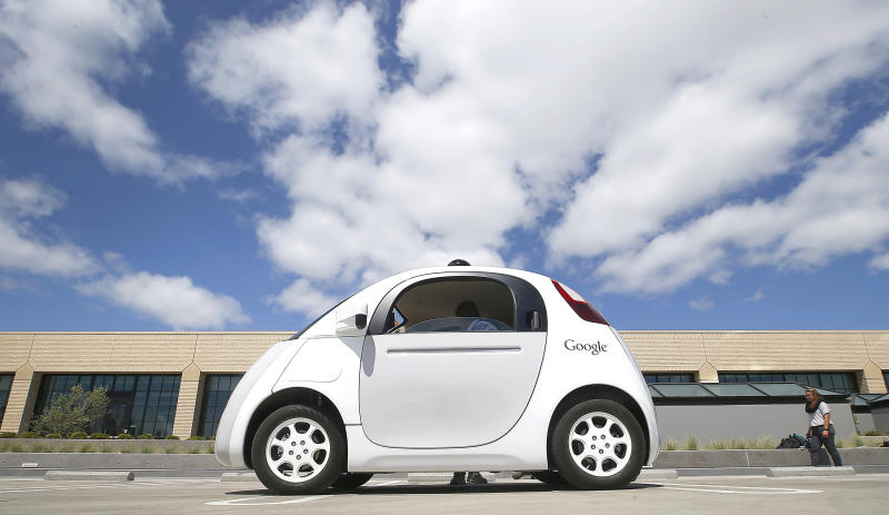 <p> FILE - In this May 13, 2015, file photo, Google's new self-driving prototype car is introduced at the Google campus in Mountain View, Calif. Cars with no steering wheel, no pedals and nobody at all inside could be driving themselves on California roads by the end of 2017, under proposed new rules that would give a powerful boost to the technology from the nation's most populous state. (AP Photo/Tony Avelar, File) </p>