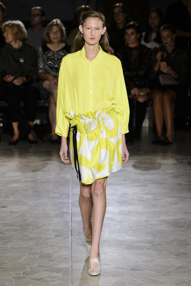 <p><i>Model wears a yellow blouse and pattern skirt from the SS18 Arthur Arbesser collection. (Photo: ImaxTree) </i></p>