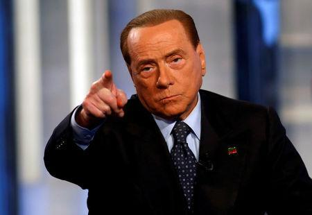 """FILE PHOTO: Italy's former Prime Minister Silvio Berlusconi gestures as he the attends television talk show """"Porta a Porta"""" (Door to Door) in Rome, Italy, November 30, 2016. REUTERS/Remo Casilli/File Photo"""