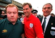 England National Soccer Team coach Glenn Hoddle (centre) arrived back at Luton Airport this evening (Monday). Photo by Peter Jordan/PA.