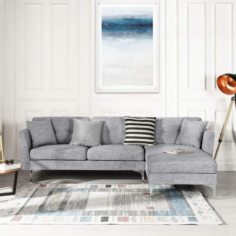 "<p>Brighten up your room with this <a href=""https://www.popsugar.com/buy/Grey%20Upholstered%20Linen%20Sectional%20Sofa-473004?p_name=Grey%20Upholstered%20Linen%20Sectional%20Sofa&retailer=amazon.com&price=600&evar1=casa%3Aus&evar9=46426423&evar98=https%3A%2F%2Fwww.popsugar.com%2Fhome%2Fphoto-gallery%2F46426423%2Fimage%2F46426424%2FGrey-Upholstered-Linen-Sectional-Sofa&list1=shopping%2Cfurniture%2Csofas%2Csmall%20space%20living%2Chome%20shopping&prop13=api&pdata=1"" rel=""nofollow"" data-shoppable-link=""1"" target=""_blank"" class=""ga-track"" data-ga-category=""Related"" data-ga-label=""https://www.amazon.com/Upholstered-Sectional-L-Shape-Furniture-Sectionals/dp/B07V4B6Z4G/ref=sr_1_45?crid=3QHYBH9P9Q7H2&amp;keywords=sectional+sofa&amp;qid=1564158415&amp;s=gateway&amp;sprefix=section%2Caps%2C205&amp;sr=8-45"" data-ga-action=""In-Line Links"">Grey Upholstered Linen Sectional Sofa</a> ($600).</p>"
