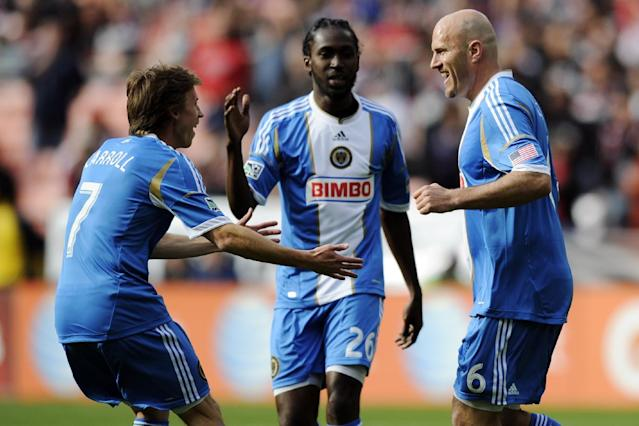 Philadelphia Union forward Conor Casey (6) celebrates his goal with Brian Carroll (7) and Keon Daniel (26) against D.C. United during the first half of an MLS soccer match, Sunday, April 21, 2013, in Washington. (AP Photo/Nick Wass)